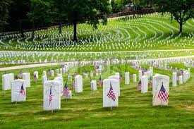 memorial day graveside decorations tombstone at grave of soldier with american flag stock photo