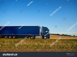 Blue Truck Traveling On Highway Horizon Stock Photo (Edit Now ...