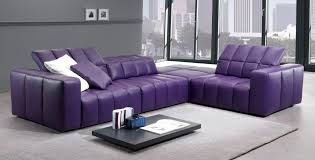 purple sofa with cushions on grey ceramic flooring tile soft