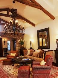 Living Room With Large Wrough Iron Chandelier And Spanish Style Furniture