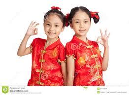 asian twins girls in chinese cheongsam dress show ok sign stock