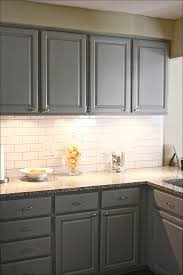 kitchen white kitchen cabinets with dark floors gray countertops