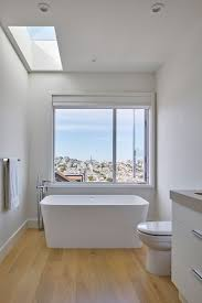This San Francisco Home Is An Urban Oasis For A Family Of Four ... Nice Bathroom Design San Francisco Classic Photo 19 Of In Budget Breakdown A Duo Give Their Interior Company Regan Baker West Clay Grey And White Luxury Woodnotes Novelty Haas Lienthal House Victorian Bath San Francisco Otograph By Remodel Steam Shower Black Hex Floor Tiles Remodeling Pottery Barn Kids With Marble Tile Bathroom Rustic And Vanities Lovely Restoration Hdware Locationss Home Faucets New Traditional House Tour Apartment Therapy Reveal Meets Modern A