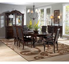 dark wood dining room set with leg table costa dorada collection