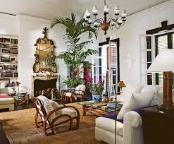 Ralph Ricky Laurens Home On Jamaica An Gilt Mirror Hangs Above The Fireplace In Living Room Which Also Has A Reading Corner