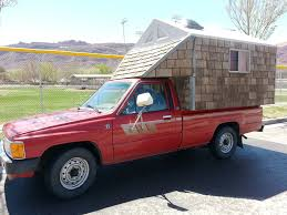 Small Red Toyota Truck With Hand Built Cedar Home In Truck Bed ... 12 Perfect Small Pickups For Folks With Big Truck Fatigue The Drive Toyota Tacoma Reviews Price Photos And Specs Car 2017 Sr5 Vs Trd Sport Best Used Pickup Trucks Under 5000 20 Years Of The Beyond A Look Through Tundra Wikipedia 2016 Hilux Unleashed Favored By Militants Worlds V6 4x4 Manual Test Review Driver Heres Exactly What It Cost To Buy And Repair An Old Why You Should Autotempest Blog Think Future Compact Feature Trend