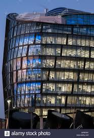 contemporary office building at dusk with coloured lights in