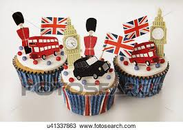 Three London Themed British Celebration Cupcakes White Iced Sponge Fairy Cake Topped With Red And Blue Sprinkles Small Union Jack Flags Big Ben Bus