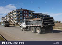 Construction Dump Trucks At New Condominium Building In Suburban ... 339 Best Suburbans Images On Pinterest Chevrolet Suburban Chevy X Luke Bryan Suburban Blends Pickup Suv And Utv For Hunters Pressroom United States Images Lifted Trucks 1999 K2500 454 2018 Large 3 Row 1993 93 K1500 1500 4x4 4wd Tow Teal Green Truck 1959 Napco 4x4 Mosing Motorcars 1979 Sale Near Cadillac Michigan 49601 Reviews Price Photos 1970 2wd Gainesville Georgia Hemmings Find Of The Day 1991 S Daily 1966