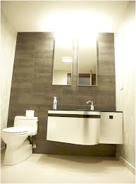 Dark Colors For Bathroom Walls by A Chandelier Above The Luminous And Round White Sink And Plain