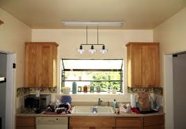 top pendant light above kitchen sink img and also outstanding sets