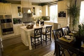 A White Kitchen With Glass Tile Backsplash And Hardwood Flooring Small Island