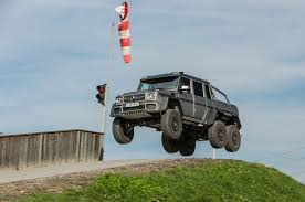 2014 Mercedes-Benz G63 AMG 6x6 First Drive - Motor Trend Watch This Valet Kick A 7000 Mercedes Gwagen 6x6 Out Of Monaco The 2018 Hennessey Ford Raptor At Sema Overthetop Badassery Benz Truck 6 Wheels Best Image Kusaboshicom Gclass Luxury Offroad Suv Mercedesbenz Usa Stanced 6wheel Chevy Silverado Rides On Forgiato Dually With G63 Amg 66 Top Gear Review Karagetv Wikipedia Xclass By Carlex Design Is Maybach Pickup Trucks Velociraptor Vs Youtube Scs Softwares Blog Get Behind The Wheel Of New Goliath Brings Meaning To Chevys Trail