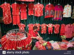 traditional chinese clothes stall vendor in alleyway market