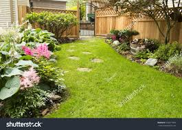 Garden Path Back Yard Path Leads Stock Photo 555817909 - Shutterstock Garden Eaging Picture Of Small Backyard Landscaping Decoration Best Elegant Front Path Ideas Uk Spectacular Designs River 25 Flagstone Path Ideas On Pinterest Lkway Define Pathyways Yard Landscape Design Ma Makeover Bbcoms House Design Housedesign Stone Outdoor Fniture Modern Diy On A Budget For How To Illuminate Your With Lighting Hgtv Garden Pea Gravel Decorative Rocks