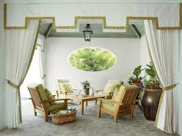 White And Green Valance Paired With Curtains Accented Trim Open To Reveal An Outdoor Living Space Filled A Gray Teak Plank Ceiling