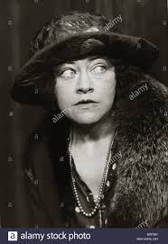 Woman Wearing 1920s Style Clothing Coat Big Hat And Necklace Fashion Women Womens Lady