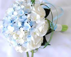 Blue & White bouquet of blue & cream hydrangeas large white lilies