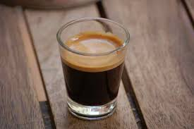 Traditionally An Espresso Is A Highly Concentrated Coffee Beverage Created By Using Specialized Machine That Forces Pressurized Hot Water Through Finely