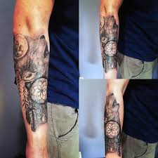 Guy With Howling Wolf Dreamcatcher Tattoos