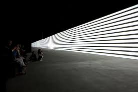 Infinite Patterns of Light Dance Across a 130 Foot Wall