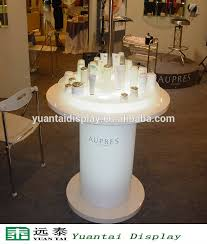 White Round Cosmetic Display Table With LED Light Furniture Design For Retail Store