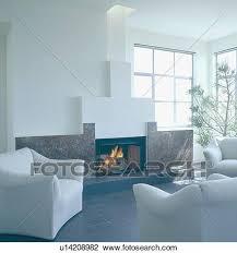 angezündet feuer in granit kaminofen in modernes weiß