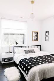 Small Monochrome Bedroom With A Black Metal Bed Frame Simple Bedding Pendant Light