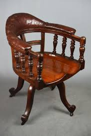 Antique Dark Walnut & Worn Brown Leather Captain's Desk Chair On ... Ancestral Rocking Chair Gio Ebony Antique Rocking Chair Sold The Savoy Flea With Sewing Drawer Collectors Weekly How To Update A Pair Of Wornout Chairs Hgtv A Country Sheraton Youth Sized Thumb Back Rocker 19th Century For Safavieh Alexei Natural Brown Acacia Wood Patio Windsor Kitchen Stripe Caning Seat Weaving Handbook Illustrated Wooden Stock Photos Upholstered Redo Prodigal Pieces