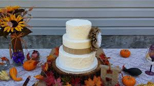 Rustic Wedding Cake With Burlap Ribbon And A Lace Flower