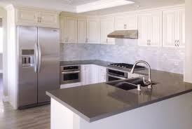 white kitchen cabinets with gray quartz countertops trekkerboy