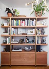 Decorating Bookshelves Without Books by 25 Unexpected Ways To Decorate With Plants Brit Co