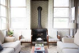 Small Country Formal Living Room Photo In New Orleans With White Walls And A Wood Stove