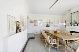 The Dining Room Is Characterized By Concrete Resin Floors And Unpainted Plaster Walls Photograph