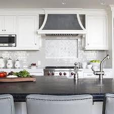 kitchen with white arabesque backsplash transitional kitchen