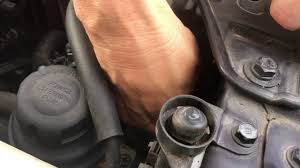 how to replace the low beam headlight bulb on a 2006 hyundai
