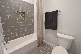 contemporary bathroom with high ceiling by green st