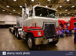 An International Cabover Semi Truck And A Stepdeck Trailer Are ...