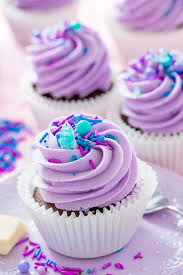 Chocolate cupcakes with creamy white chocolate centre and purple buttercream 753