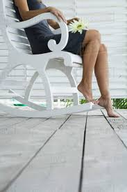 Woman Sitting In Rocking Chair On Porch, Holding Flower On D1144_4_981 Rocking Chair For Nturing And The Nursery Gary Weeks Coral Coast Norwood Inoutdoor Horizontal Slat Back Product Review Video Fort Lauderdale Airport Has Rocking Chairs To Sit Watch Young Man Sitting On Chair Using Laptop Stock Photo Tips Choosing A Glider Or Lumat Bago Chairs With Inlay Antesala Round Elderly In By Window Reading D2400_140 Art 115 Journals Sad Senior Woman Glasses Vintage Childs Sugar Barrel Album Imgur Gaia Serena Oat Amazoncom Stool Comfortable Cushion