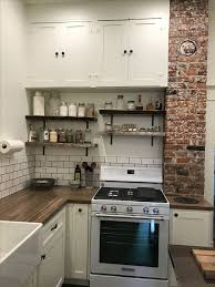 Old House Kitchen Remodel With Blue Pine Raw Edge Shelves Exposed Brick Chimney And