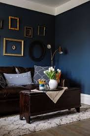 Stickman Death Living Room by Chic Seating Area With A Brown Sofa And A Navy Accent Wall And