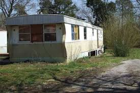 2 This Older Mobile Home Shows The Effects Of Age And Neglect Openings In Walls Exterior Covering Can Allow Fire To Reach Houses Unprotected
