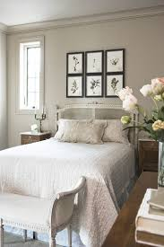 French Country Style Bedroom With Light Taupe Walls And A Bed