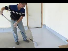 how to epoxy coat a garage floor this house