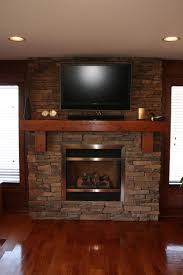 InteriorCharming Stone Gas Fireplace With Black Fence And Pallet Wooden Flooring Ideas Cool Home