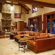 Home Ranch Style Interior With Fireplace And Sectional Sofa Coffee Table Exposed Beams
