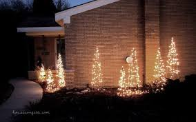 DIY Outdoor Christmas Decor Made From Tomato Cages And Lights