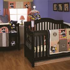 this vintage style 4 piece crib bedding set showcases mickey mouse