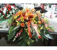 Casket Spray Orange And Yellow In Chicago IL Soukal Floral Co Greenhouses